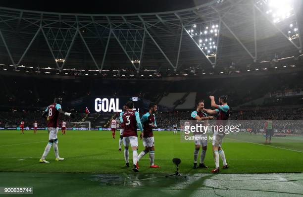 General view as Andy Carroll of West Ham United celebrates scoring his sides first goal with his team mates during the Premier League match between...