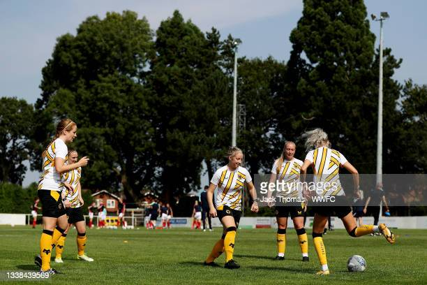 General view as Anna Price, Amber Hughes, Laura Cooper, Kelly Darby and Tammi George of Wolverhampton Wanderers warm up ahead of the FAWNL Northern...