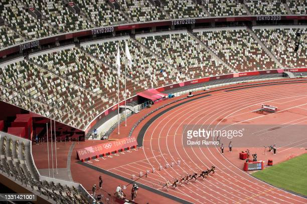 General view as Athletes compete during round one of the Women's 100m heats on day seven of the Tokyo 2020 Olympic Games at Olympic Stadium on July...