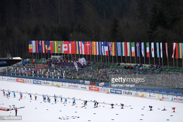 General view as athletes compete in front of the empty stand which is filled with cardboard cutouts during the Men's Cross Country Skiathlon 15 km/15...