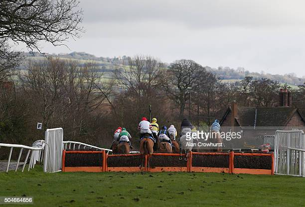 A general view as back markers clear a hurdle at Ludlow racecourse on January 12 2016 in Ludlow England