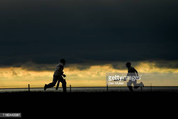 A general view as batsmen run between the wickets during the Cornwall Cricket League Division 2 East match between Bude CC and Menheniot/Looe CC at...