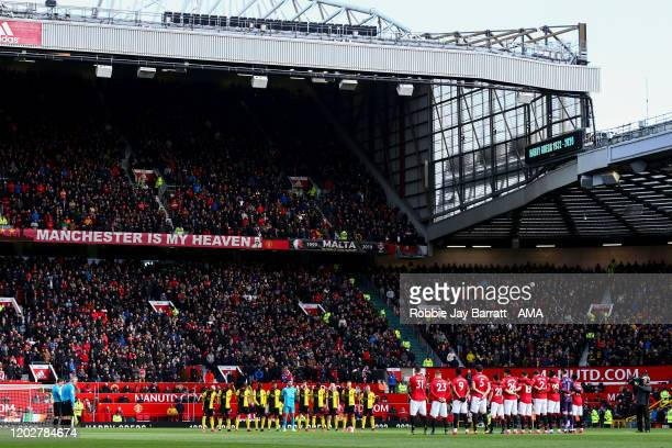 A general view as both teams pay their respects to former Manchester United player Harry Gregg during the Premier League match between Manchester...