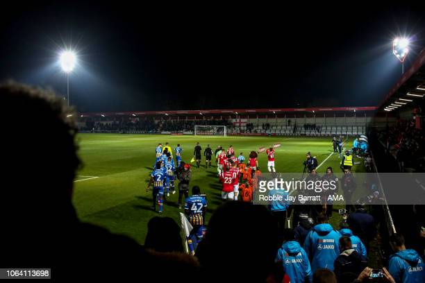 General view as both teams walk out on to the pitch at Moor Lane, the home stadium of Salford City during the Emirates FA Cup First Round Replay...
