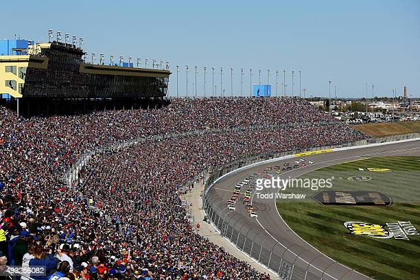 General view as Brad Keselowski, driver of the Miller Lite Ford, and Carl Edwards, driver of the Sport Clips Toyota, lead the field to the green flag...