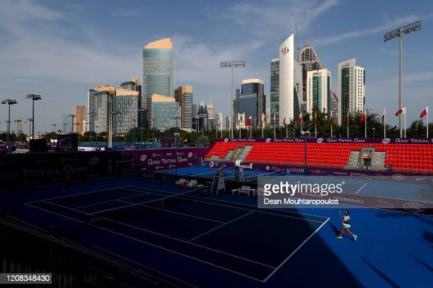 General view as Carla Suarez Navarro of Spain returns a forehand against Zhang Shuai of China during Day 2 of the WTA Qatar Total Open 2020 at...