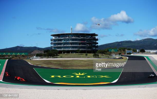 General view as Charles Leclerc of Monaco driving the Scuderia Ferrari SF1000, Sebastian Vettel of Germany driving the Scuderia Ferrari SF1000 and...