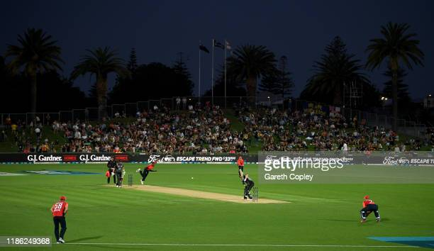 General view as Chris Jordan of England bowls to Colin Munro of New Zealand during game four of the Twenty20 International series between New Zealand...