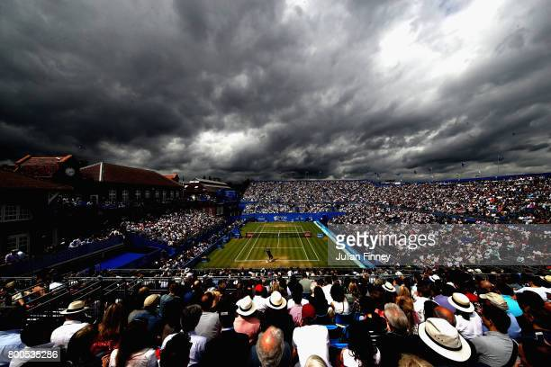 A general view as clouds cover centre court during the mens singles semifinals match between Marin Cilic of Croatia and Gilles Muller of Luxembourg...