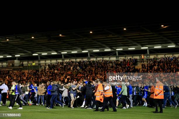 General view as Colchester United fans invade the pitch following victory in the penalty shoot out during the Carabao Cup Third Round match between...