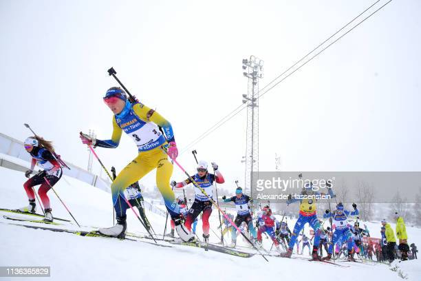 A general view as competitors make their way up a hill in the Women's Mass Start at the IBU Biathlon World Championships on March 17 2019 in...