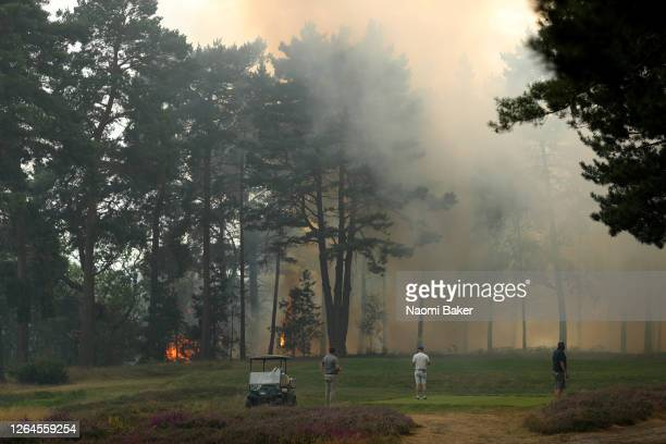 General view as course staff work to stop a fire which spread from Cobham heath over to the 9th and 10th holes as smoke is seen covering the course...