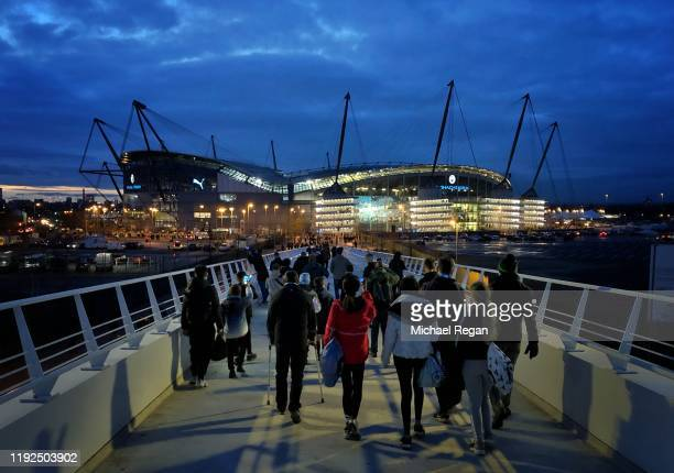 General view as fans arrive outside the stadium ahead of the Premier League match between Manchester City and Manchester United at Etihad Stadium on...