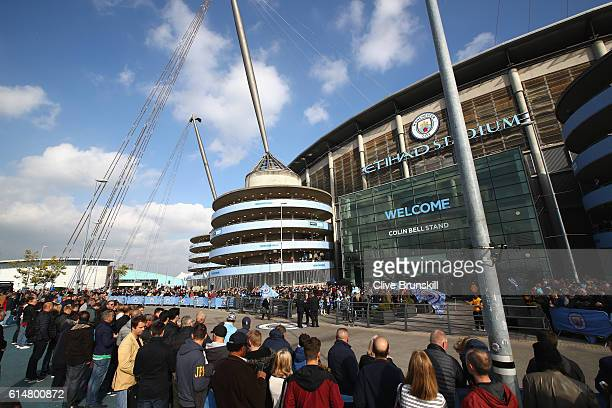 A general view as fans gather outside the ground prior to the Premier League match between Manchester City and Everton at Etihad Stadium on October...