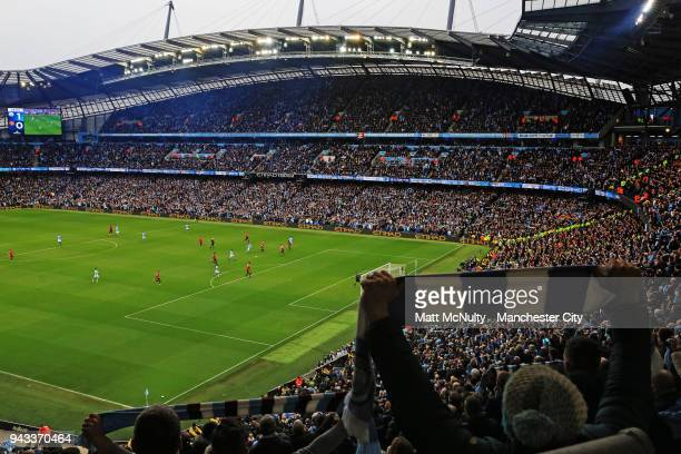 A general view as fans hold up scarves during the Premier League match between Manchester City and Manchester United at Etihad Stadium on April 7...