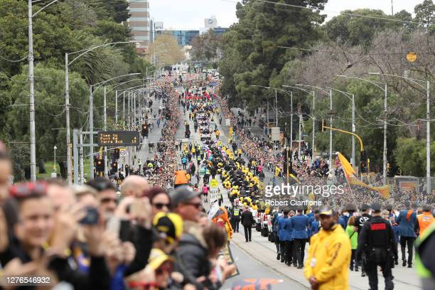 A general view as fans line the parade route during the 2019 AFL Grand Final Parade on September 27 2019 in Melbourne Australia