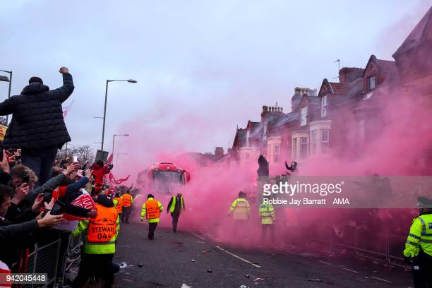 A general view as fans of Liverpool let of flares as the Liverpool team bus arrives prior to the UEFA Champions League Quarter Final first leg match...