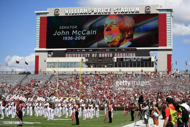 A general view as fans pause for a moment of silence for the late US Senator John McCain prior to the game between the Coastal Carolina Chanticleers...