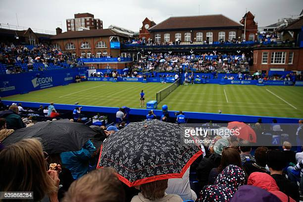 A general view as fans watch the action under umbrellas during day one of the Aegon Championships at Queens Club on June 13 2016 in London England