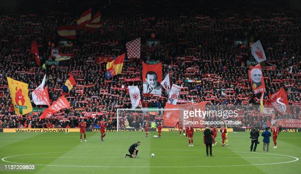A general view as fans wave their flags and banners in The Kop before the Premier League match between Liverpool and Chelsea at Anfield on April 14...