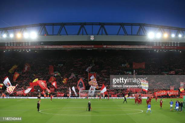 A general view as fans wave their flags and banners in The Kop before the Premier League match between Liverpool FC and Manchester City at Anfield on...