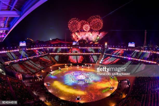 TOPSHOT General view as fireworks are set off during the closing ceremony of the Pyeongchang 2018 Winter Olympic Games at the Pyeongchang Stadium on...