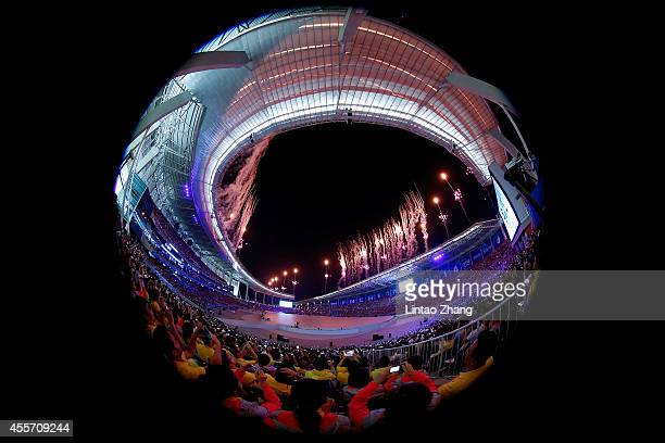 A general view as fireworks light up the sky for the Opening Ceremony ahead of the 2014 Asian Games at Incheon Asiad Stadium on September 19 2014 in...