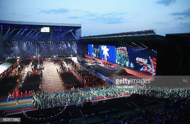 A general view as Flag bearer and Cyclist Anna Meares of Australia leads the Australian athletes during the Opening Ceremony for the Glasgow 2014...