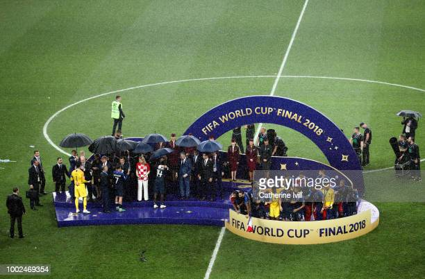 General view as France receive their medals in the rain after the 2018 FIFA World Cup Russia Final between France and Croatia at Luzhniki Stadium on...