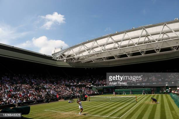 General view as Garbine Muguruza of Spain serves against Ons Jabeur of Tunisia during their Ladies Singles Third Round match during Day Five of The...