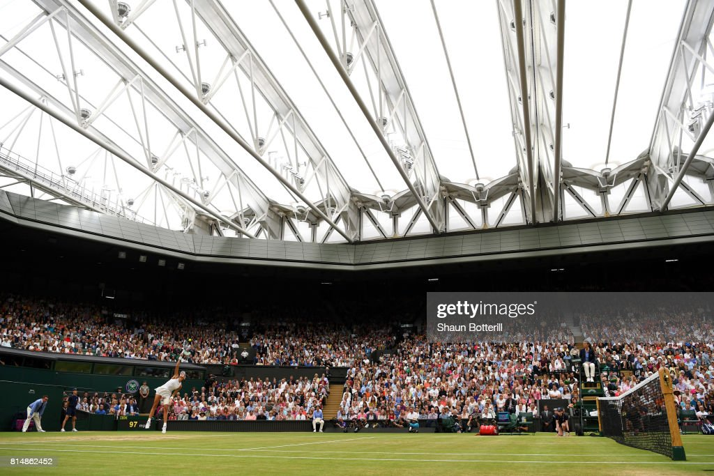A general view as Garbine Muguruza of Spain serves under the closed centre court roof during the Ladies Singles final against Venus Williams of The United States on day twelve of the Wimbledon Lawn Tennis Championships at the All England Lawn Tennis and Croquet Club at Wimbledon on July 15, 2017 in London, England.