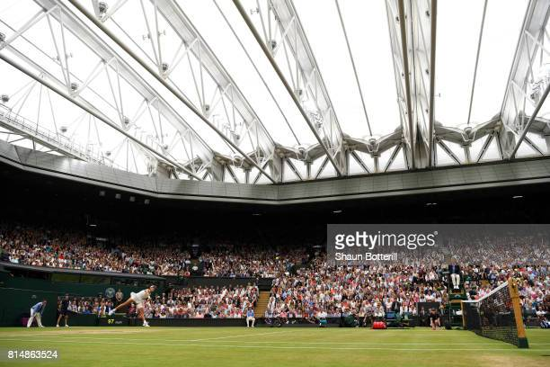A general view as Garbine Muguruza of Spain serves under the closed centre court roof during the Ladies Singles final against Venus Williams of The...