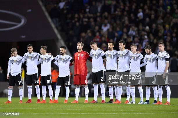A general view as german players pay their tribute to former german player Hans Schafer who passed away on November 7 before the international...