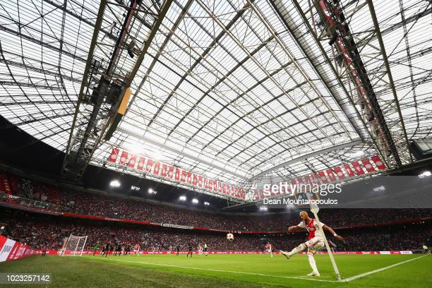 A general view as Hakim Ziyech of Ajax takes a corner during the Eredivisie match between Ajax and Emmen at Johan Cruyff Arena on August 25 2018 in...