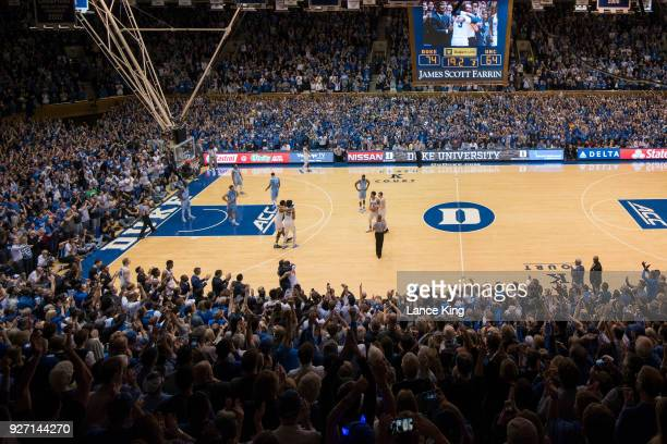 A general view as head coach Mike Krzyzewski hugs Grayson Allen of the Duke Blue Devils near the end of their game against the North Carolina Tar...