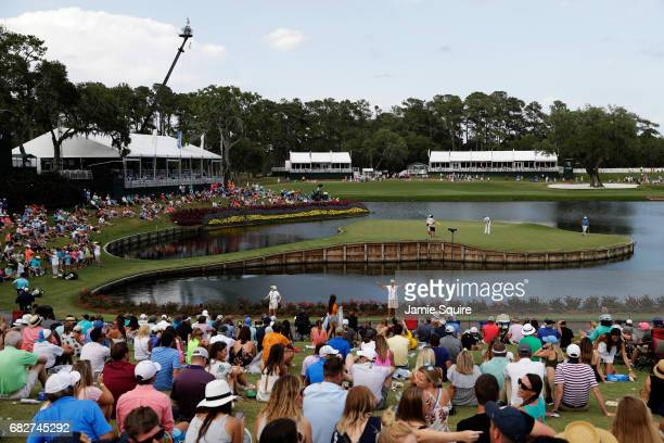 A general view as Ian Poulter of England putts on the 17th green during the third round of THE PLAYERS Championship at the Stadium course at TPC...