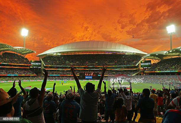 A general view as Indian fans in the crowd celebrate as a Pakistan wicket falls during the 2015 ICC Cricket World Cup match between India and...