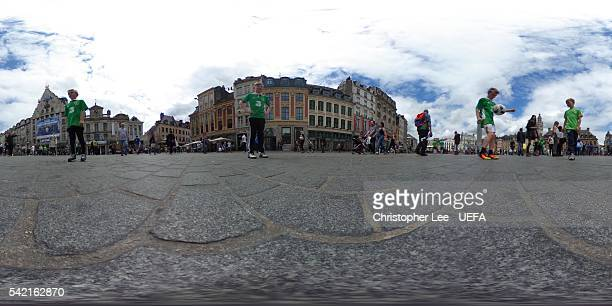 General view as Irish fans play football prior to the UEFA EURO 2016 Group E match between Italy and Republic of Ireland at Grande Place on June 22,...
