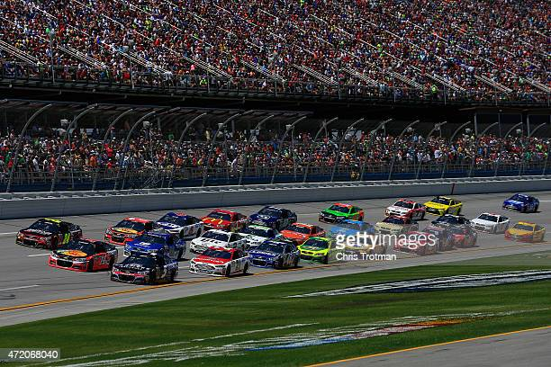 General view as Jeff Gordon driver of the Drive To End Hunger Chevrolet Tony Stewart driver of the Bass Pro Shops/Tracker Boats Chevrolet and Kasey...
