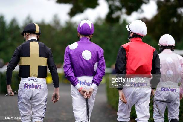 A general view as jockeys make their way to the parade ring at Kempton Park Racecourse on October 10 2019 in Sunbury England