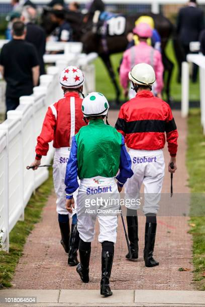A general view as jockeys make their way to the parade ring at Newbury Racecourse on August 17 2018 in Newbury United Kingdom