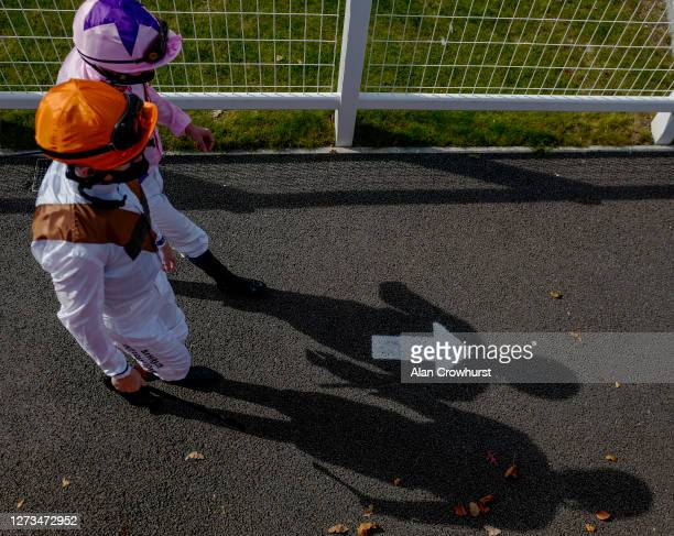 A general view as jockeys make their way to the parade ring for the Heatherwold Stud EBF Novice Stakes at Newbury Racecourse on September 19 2020 in...