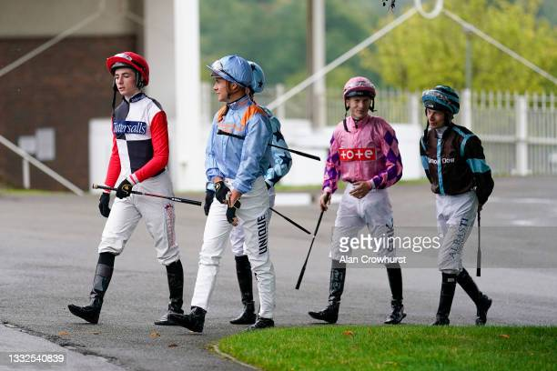 General view as jockeys make their way towards the parade ring at Sandown Park on August 05, 2021 in Esher, England.