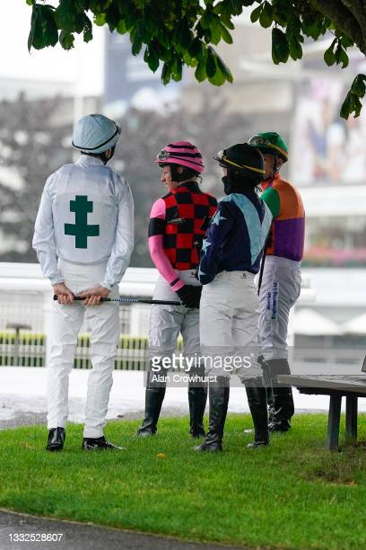General view as jockeys shelter from the rain before the first race at Sandown Park on August 05, 2021 in Esher, England.