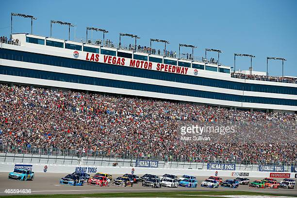 General view as Joey Logano driver of the Pennzoil Platinum Ford and Kasey Kahne driver of the Time Warner Cable Chevrolet lead the field to start...