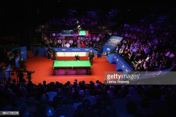 A general view as John Higgins of Scotland plays a shot during his match against Kyren Wilson of England during day fourteen of World Snooker...