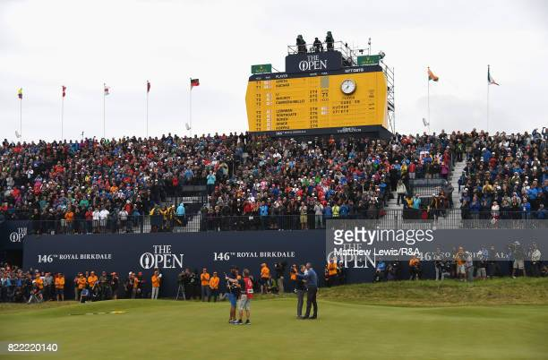 A general view as Jordan Spieth of the United States is congratulated by Matt Kuchar of the United States on the 18th green during the final round of...
