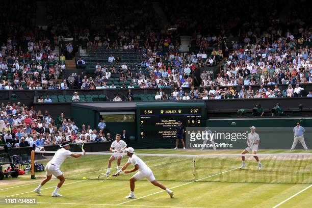 General view as Juan Sebastian Cabal of Colombia, playing partner of Robert Farah of Colombia plays a shot in their Men's Doubles final against...