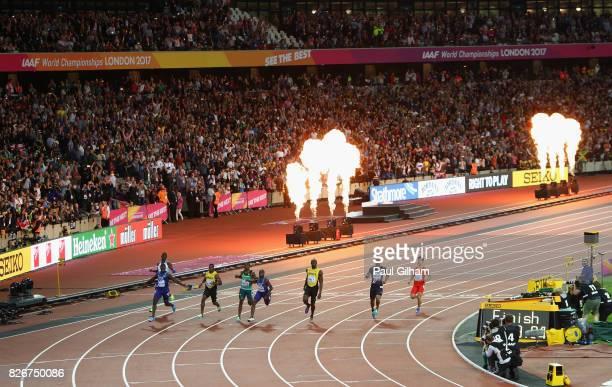 A general view as Justin Gatlin of the United States crosses the finish line and celebrates his win in the Men's 100 metres final in 992 seconds...