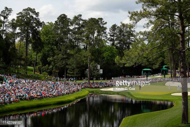 General view as Justin Rose of England putts on the 16th green during the second round of the Masters at Augusta National Golf Club on April 12, 2019...